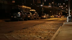 Low Angle Cobblestone Street at Night Stock Footage