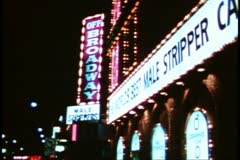 """San Francisco, 1970's, North Beach by night, sleaze, still, """"Male Stripper"""" sign Stock Footage"""