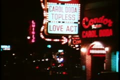 "San Francisco, 1970's, North Beach by night, neon, people, ""Carol Doda"" sign Stock Footage"