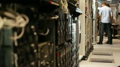 IT specialists in server room - stock footage