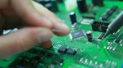 Technician solders circuit board Stock Footage