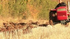 Plowing the field (tractor close up) Stock Footage