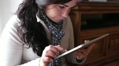 Girl using touchscreen tablet Stock Footage