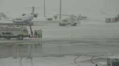 Airport, tarmac traffic on snowy airport, nice and busy Stock Footage