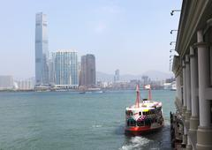 The historic star ferry leaving pier in central. hong kong Stock Photos