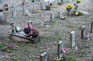 Sad grave of a young child died and other sad gravestones Stock Photos