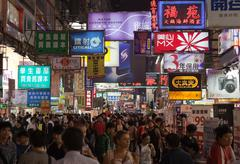 Stock Photo of busy street market at night. hong kong.