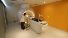 Man examined by MRI scan Stock Footage