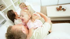Happy Young Family Playing Together Home Couch - stock footage