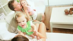 Caucasian Couple Playing Pre School Daughters Home Stock Footage