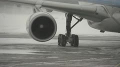 Aircraft, A330-300 taxi turn CU, snowy weather Stock Footage