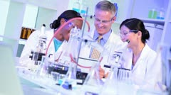 Laboratory Technicians Checking Medical Trial Results Stock Footage