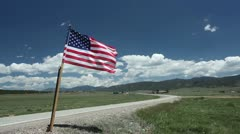 American Flag along Highway Stock Footage