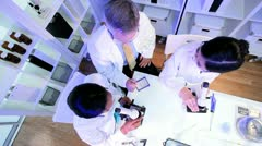 Overhead Student Doctors Using Microscopes - stock footage