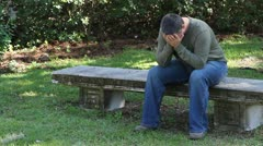 Depressed Man On Bench - stock footage