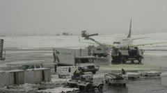 Aircraft, apron traffic in snowy weather, medium shot Stock Footage