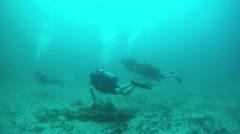 Scuba divers over sandy rock Pacific Ocean Mexico HD 0018 - stock footage