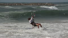 watersport clip of Kitesurfer on a surf board catching waves and wind - stock footage