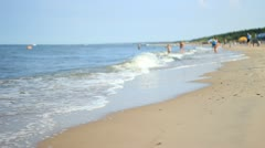 Unfocused Beach With Humans Stock Footage