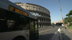 History & culture, roman Colosseum and transit buses, wide angle Stock Footage