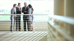 Ethnic business group on atrium Stock Footage