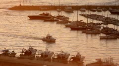 White Motor Boat Arriving at marina Stock Footage