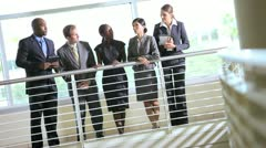 Multi ethnic business people on atrium Stock Footage