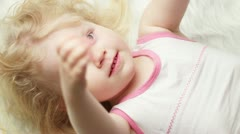Spoiled little girl in bed. closeup Stock Footage