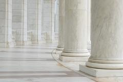 Pillars in a hallway Stock Photos