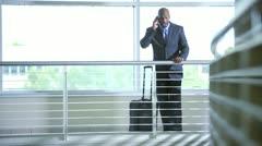 Ethnic businessman on atrium smart phone Stock Footage
