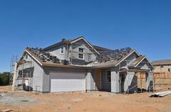 new residential home under construction - stock photo