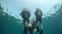 Scuba divers ready to dive Pacific Ocean Mexico HD 0040 - stock footage