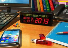 "Clock with ""Happy New Year!"" message on table - stock illustration"