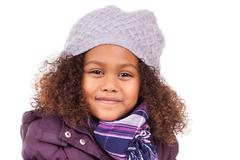 little african asian girl wearing winter clothes - stock photo