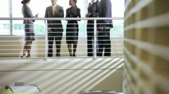 Multi ethnic team meeting on atrium Stock Footage