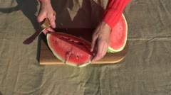 Old woman hands cutting  watermelon Stock Footage