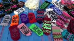 Handmade knitted mittens collection in autumn fair Stock Footage