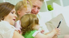Pre School Girls Parents Using Wireless Tablet Stock Footage