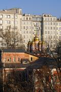 apartment and orthodox church - stock photo