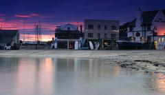 the cobb in lyme regis at sunset - stock photo