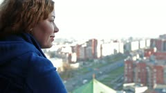 Serene face of young woman looking at the cityscape Stock Footage