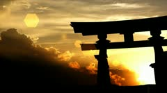 Stock Video Footage of Japanese torii gate with beautiful sunset as background.