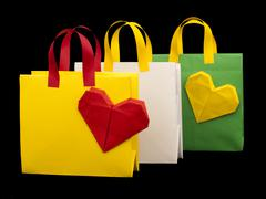shopping bags with heart. isolated origami - stock photo