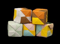 paper cubes folded origami style. - stock photo
