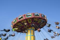Carnival Swing Ride At Fair Midway - stock photo