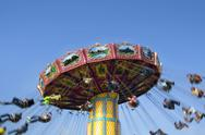 Stock Photo of Carnival Swing Ride At Fair Midway