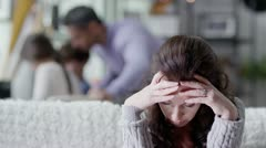 A woman who is concerned and upset is comforted by her husband - stock footage