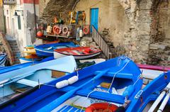 riomaggiore boats in cinque terre italy - stock photo