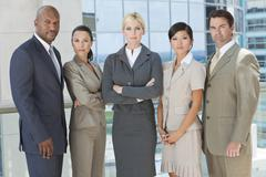 Interracial men & women business team Stock Photos