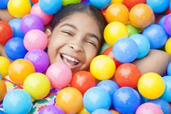 African american girl child colorful plastic balls Stock Photos